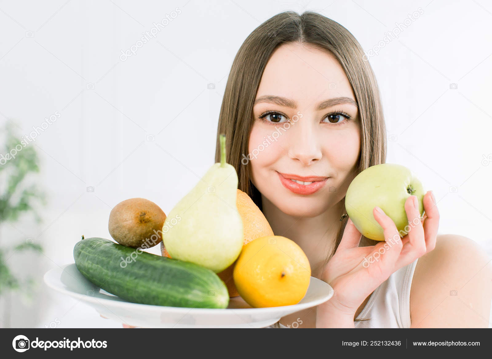 Attractive Smiling Young Caucasian Woman Holding A Plate