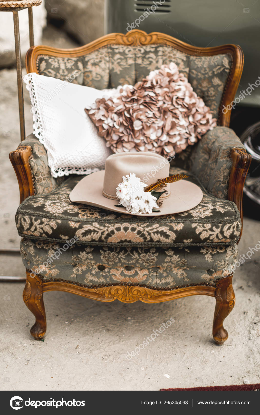 Stylish Light Brown Hat Decorated With White Flowers And Feather Lying On Vintage Armchair With Boho Pillows Decorations In Rustic Style Outdoors Desert Canyon Stock Photo C Sofiiashunkina Gmail Com 265245098