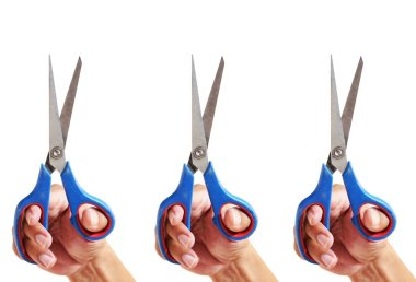 Close up three hand holding blue and red scissors isolated on white background