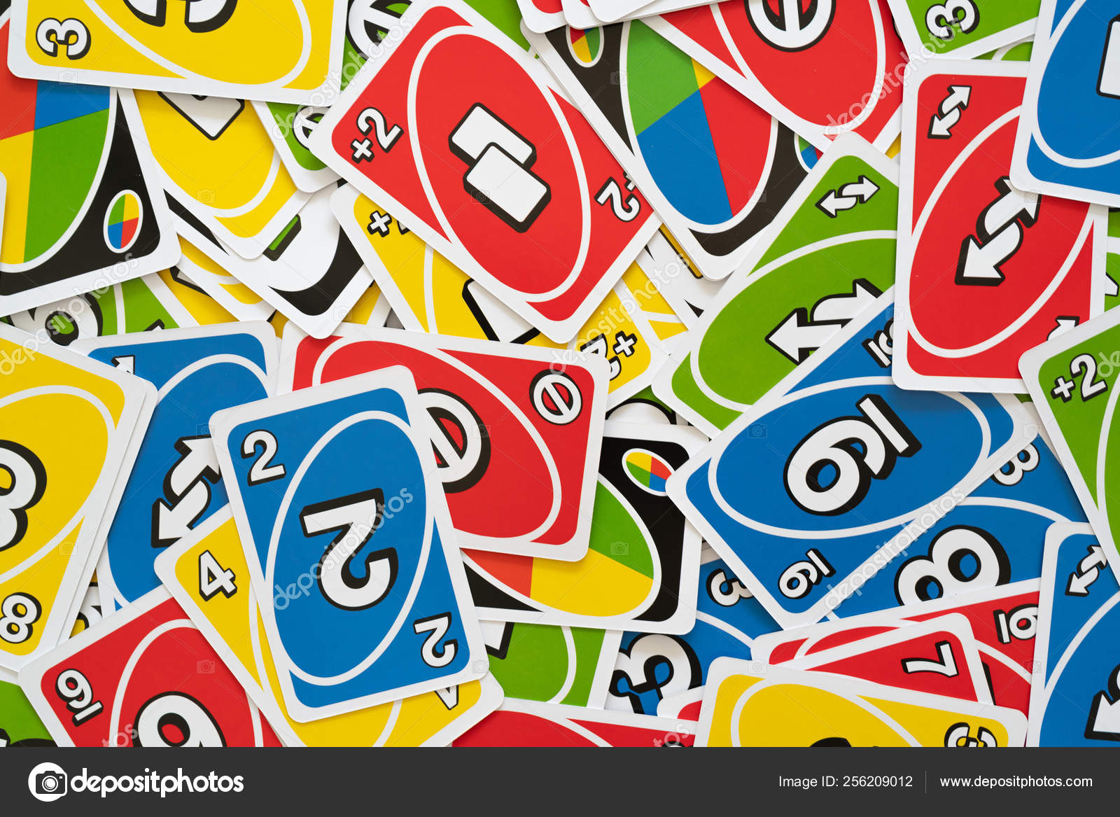 Uno game cards scattered all over the frame background