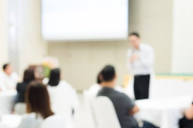Blurred background of group of business people have seminars and business training to enhance sale skils and work planning to achieve goals in hotels meeting room.