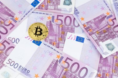 Golden bitcoin on pile of five hundred euro banknotes background. Cryptocurrency, digital currency with euro money bills. Bitcoin exchange and accepted to payment, Finance and technology concept.