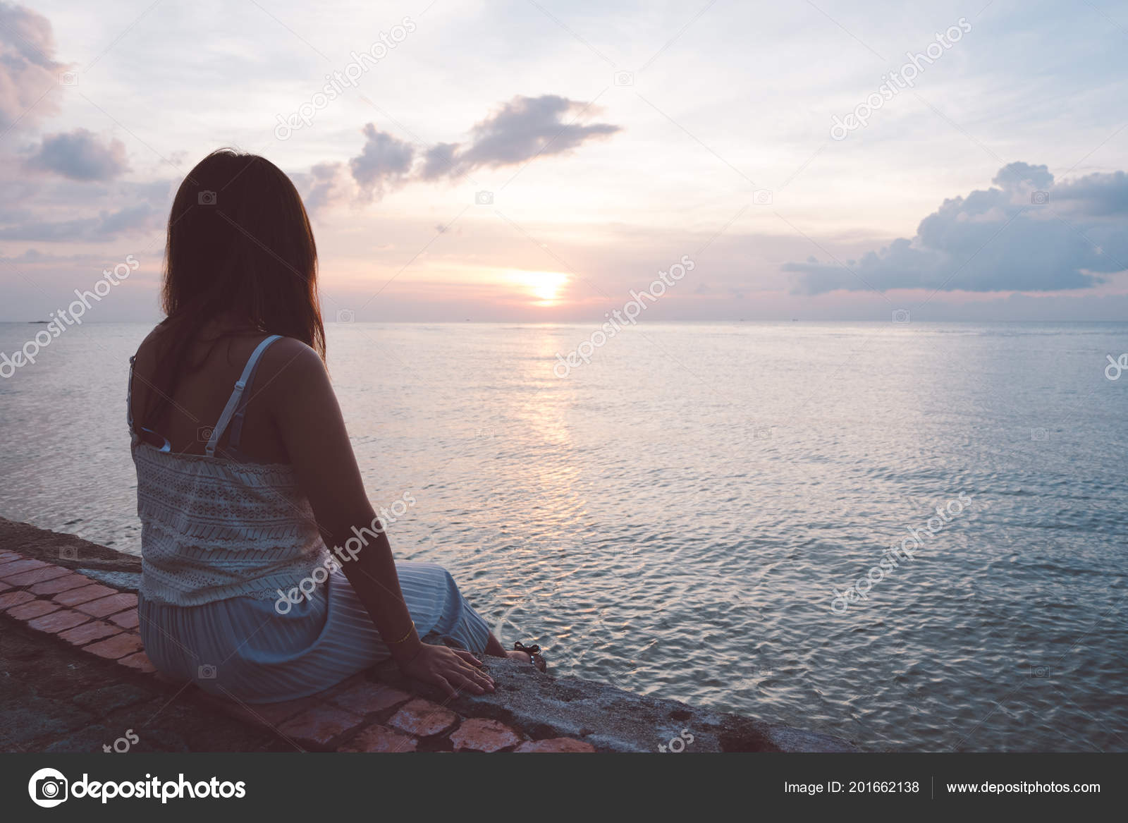 silhouette young woman sitting alone back side outdoor tropical