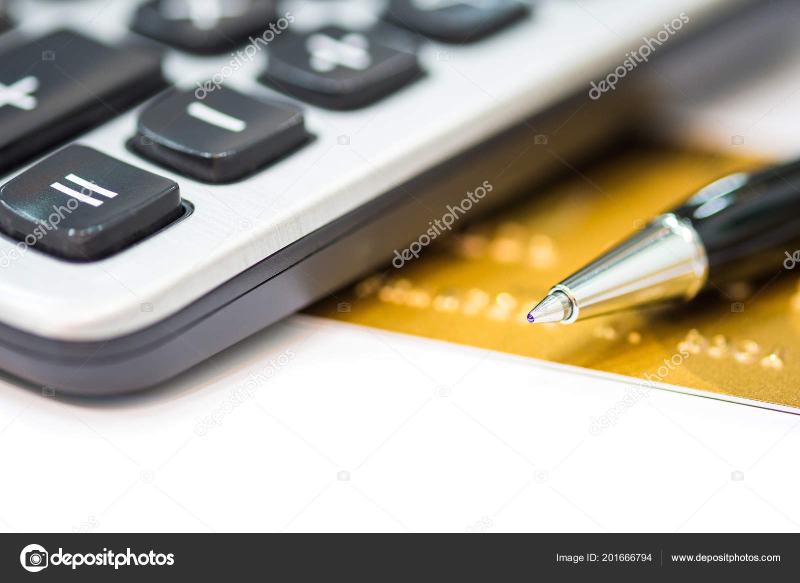 close up pen on credit card and has calculator the concept of spending plan and repayment of credit card photo by cherayut000