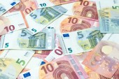 Fotografie Stack of five and ten euro banknotes as money and currency background.