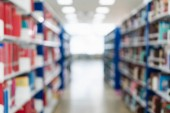 Blurred image of bookshelf in public library at school or university. Blurry image of books on shelf in bookstore. Learning and education background concept.