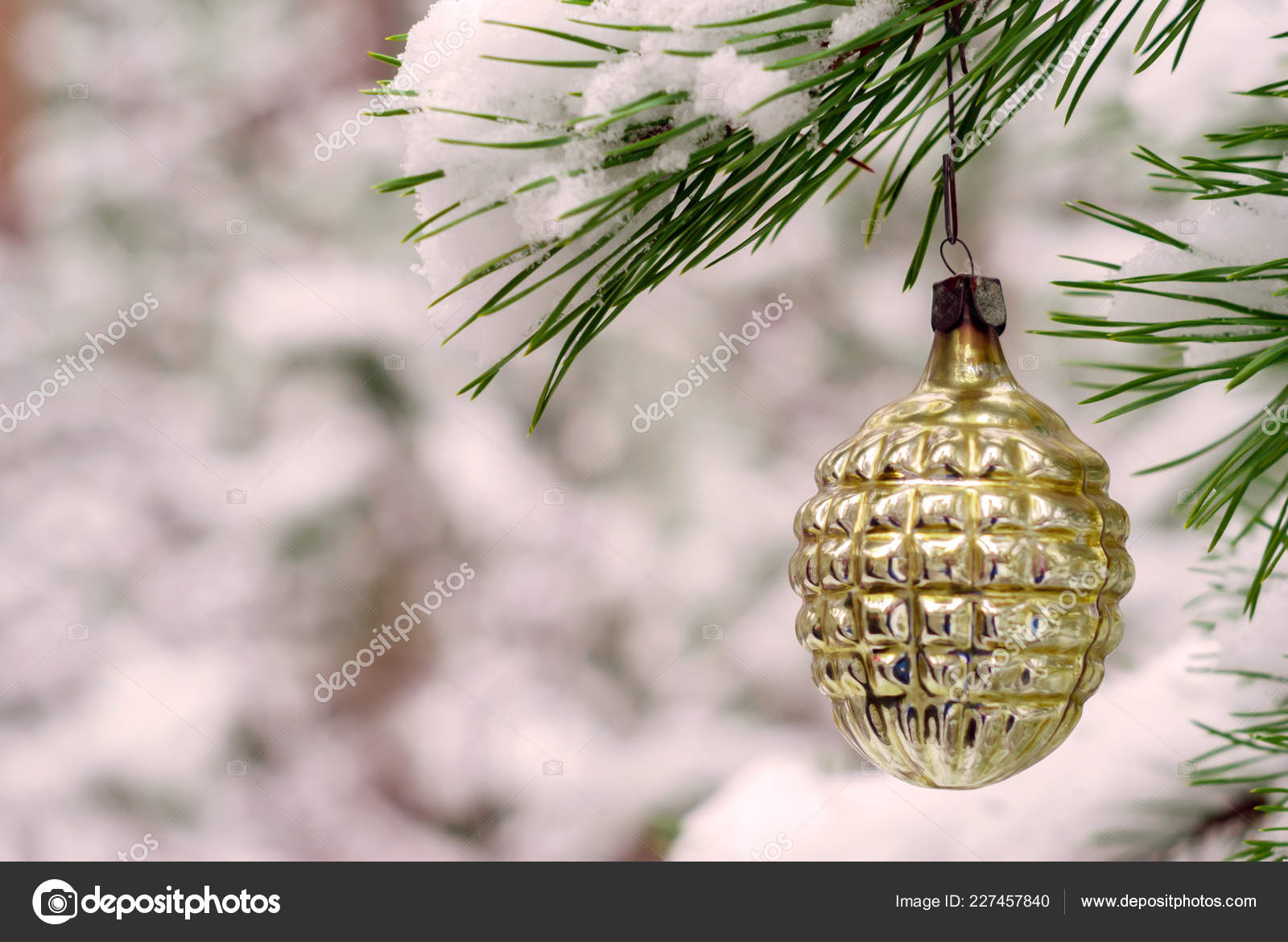 Vintage Christmas decoration on a lively fir in snowy winter forest outdoor