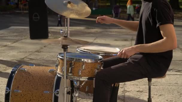 playing drums in a beautiful sunny day