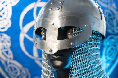 berserker, helmet of viking warrior with mail on coat of arms with drawings and viking symbolism, traditional art of northern Europe, conflict, struggle and war