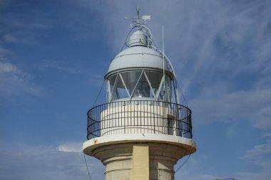 Summer, coastal lighthouse on the Playa de los Locos in Cantabria, Spain