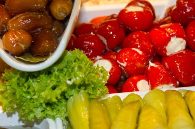 variation of healthy olives and pepperoni decorated with green salad and many colors