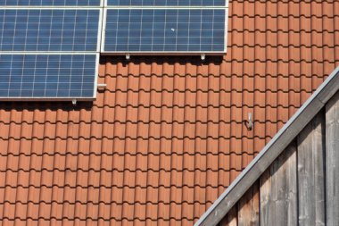 photovoltaic panels on rooftop of house in south germany at fine sunshine