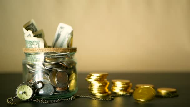 Saving money coin in jar. Symbol of investing, keeping money concept. Collecting cash banknotes in glass tin as moneybox