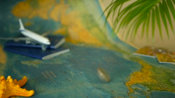 Time to travel concept. Tropical vacation theme with world map, blue passport and plane. Preparing for holliday, journey. Trip items with copy space. North America on the world map. Tourism background