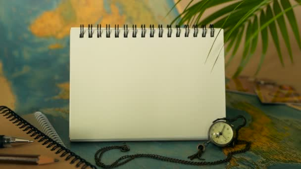 Time to travel concept. Tropical vacation theme with world map and notebook. Trip items with copy space
