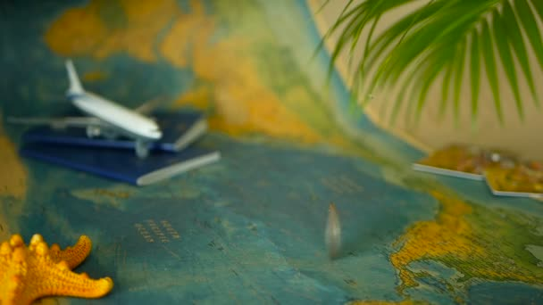 Time to travel concept. Tropical vacation theme with world map, blue passport and plane. Preparing for holliday, journey