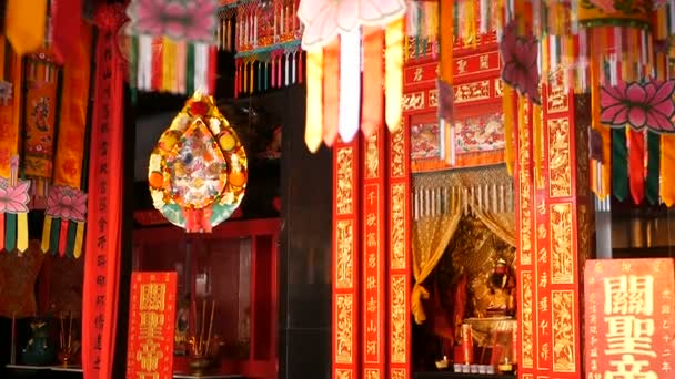 Buddhist traditional statues of chinese sacred gods on the altar inside the temple.
