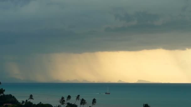 Dramatic gloomy sky with dark thunderstorm clouds over turquoise sea. Hurricane on ocean horizon. Vivid aerial timelapse beautiful view of storm raining seascape. Tropical rain season typhoon weather