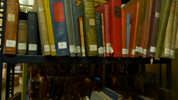 Row of old book on shelf in library. Composed row of old books with stickers on shelf in library. Kathmandu Nepal