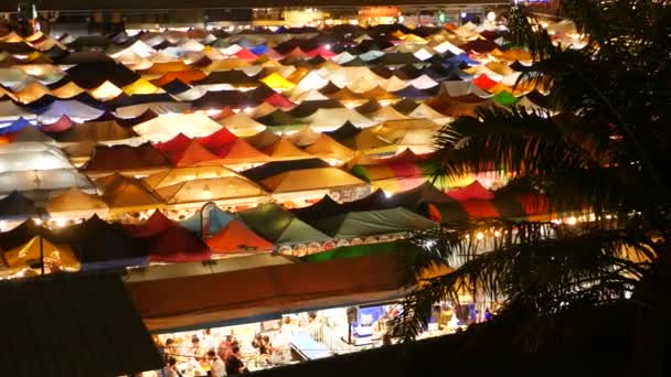 Illuminated tents of market at night. Top view of colorfull brightly illuminated tents of Ratchada Rot Fai Train Night Market on tourist street of Bangkok. Popular attraction, streetfood and shoping