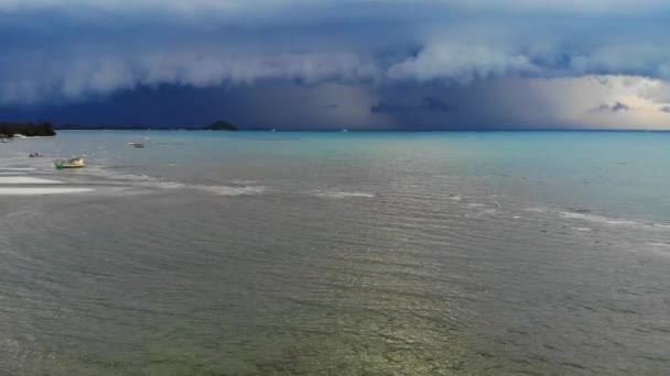 Thick clouds over waving sea. Thick blue clouds floating on sky over waving sea during wet season near Koh Samui Island. Gloomy landscape. Amazing heavy clouds, start of hurricane in Asia. Drone.