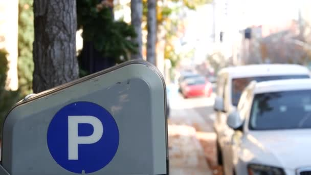 Parking lot sign as symbol of traffic difficulties and transportation issues in busy urban areas of USA. Public paid parking zone in downtown of San Diego, California. Limited space for cars in city