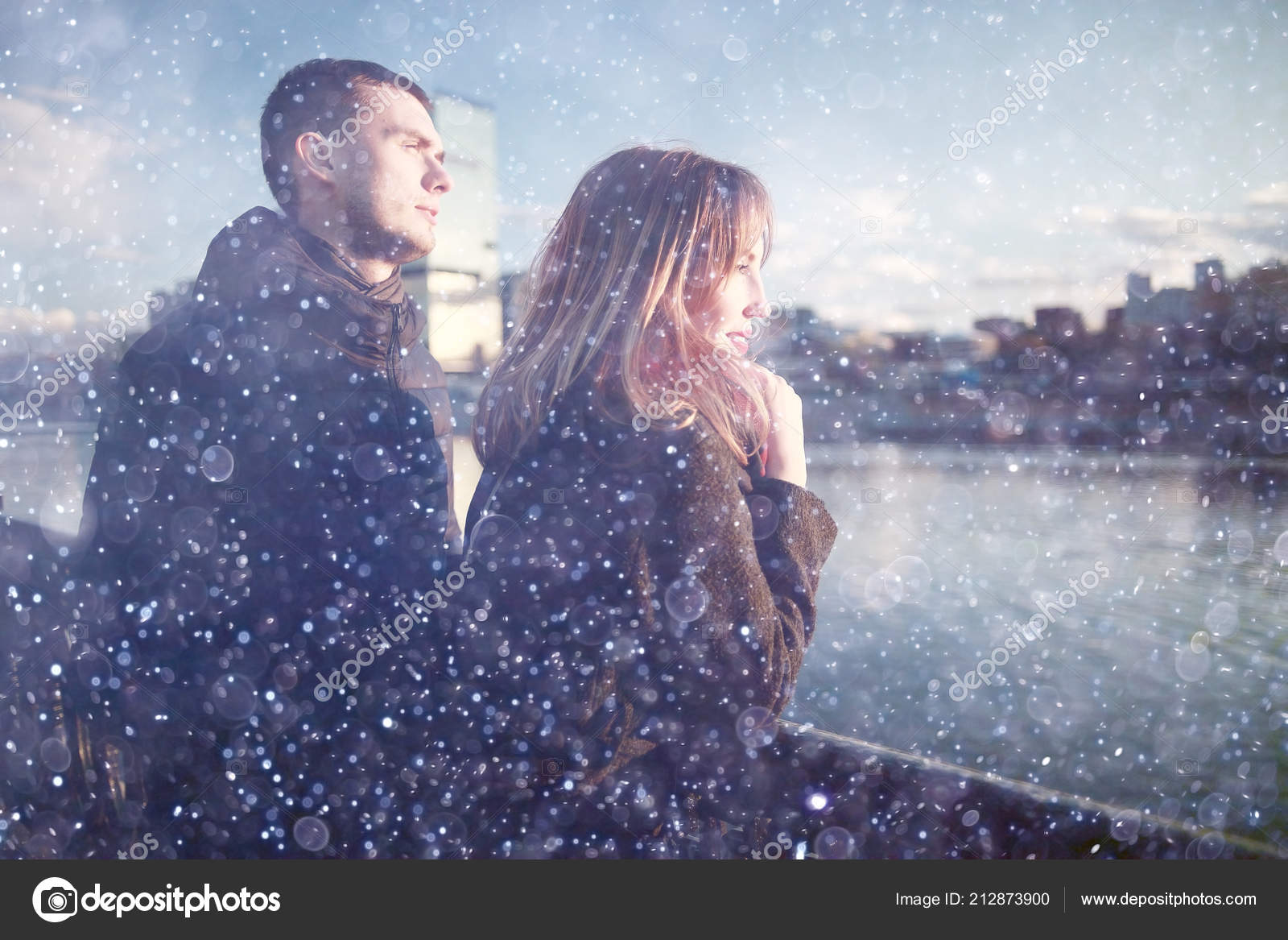 Cute love couple walking in a city park in the winter — Photo by ...