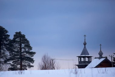 wooden church in Finland, winter landscape of Scandinavia, old architecture