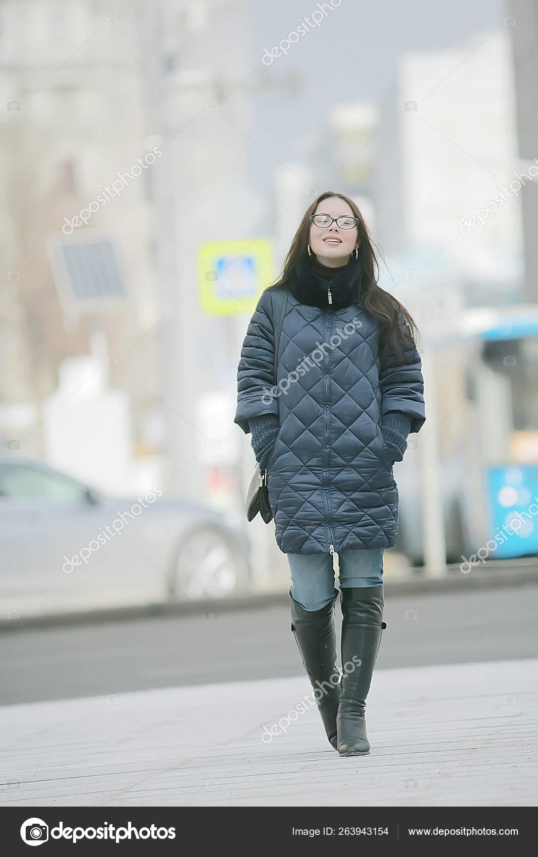 Model In Christmas Vacation.Adult Model Girl Coat Winter Walk City Christmas Vacation