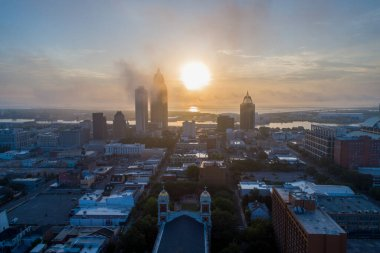 Downtown Mobile, Alabama waterfront at sunrise in July 2020