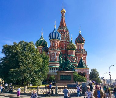 Moscow, Russia - Sept 21, 2018: Tourists walking on Red square on a background of St. Basil's Cathedral in sunny day. Official name Cathedral of the Intercession of the Most Holy Theotokos on the Moat