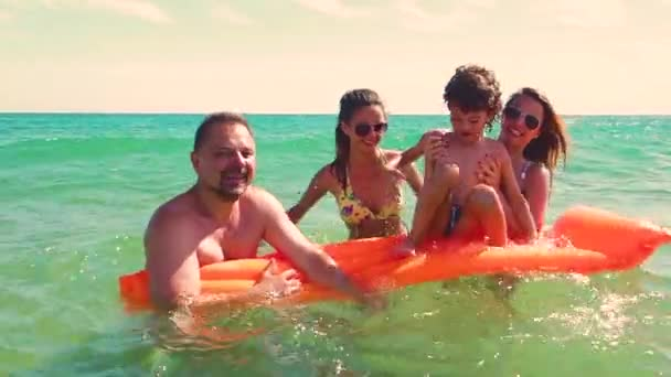 Happy family having fun in sea during vacation