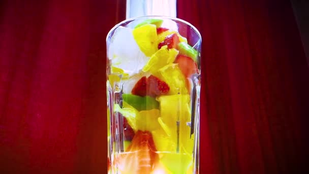 Summer lemonade. Fresh exotic fruits smoothie in glass.