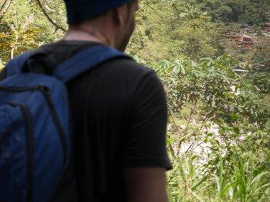 Man Arriving at Aguas Calientes City through Inca Trail in Machu Picchu, Peru