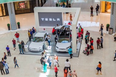 DUBAI, UAE - MARCH 12, 2017: Two Tesla cars exhibited in the Dubai Mall, one of the largest malls in the world.