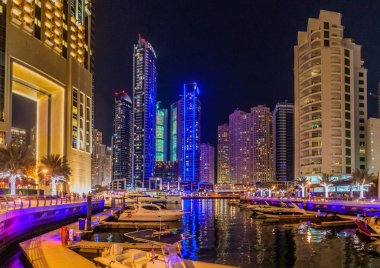 DUBAI, UAE - MARCH 12, 2017: Evening view of boats and Dubai Marina skyline, UAE