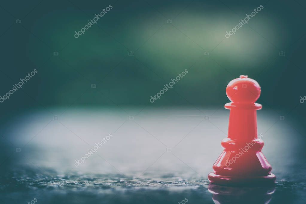 Red chess pawn on dark tone background for leadership and business strategy concept