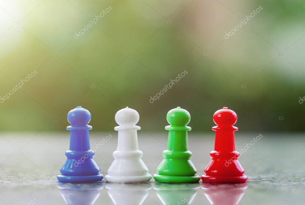 Chess pawn against blurred natural green background for teamwork and business strategy concept