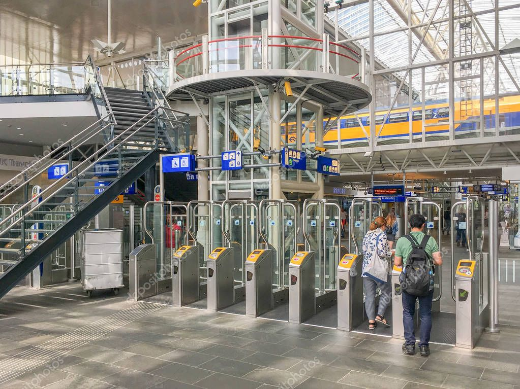 NETHERLANDS - LEIDEN - JULY 6, 2018: Check-in ports in the central station Leiden Centraal, CS in Leiden