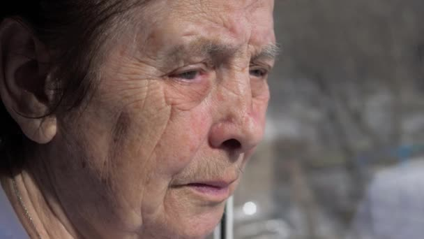Closeup Of The Face Of An Elderly Woman Suffering From Tremor Shaking Eyelids