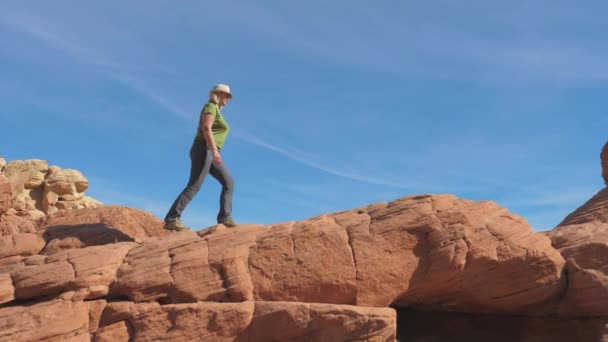 Side View A Active Woman Climbs The Red Rocks Up Background The Sky