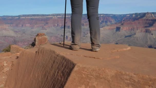 Female Tourist Enjoys The View Of The Grand Canyon From The Height
