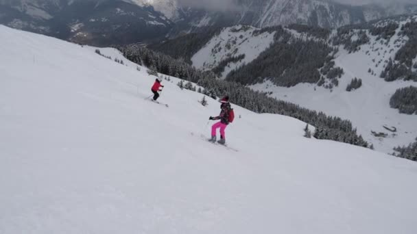 Skiers Skiing On The Difficulty Mountain Downhill In Winter Holidays