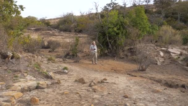 Travel Photographer Hiking In A Beautiful Place Among The Thickets In Dry Season