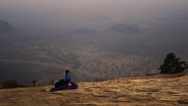Photographer On Top Of Mountain Taking Pictures On Camera Landscape At Sunset