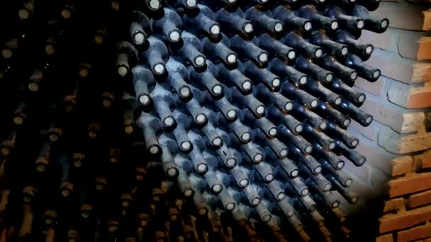 Dusty Bottles Of Wine Lie On Top Of Each Other In The Wine Cellar