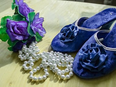 blue flowers are beautiful slippers and beads pearl