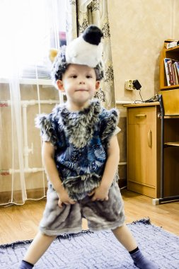A portrait of a little boy wearing a carnival suit of wolf on the