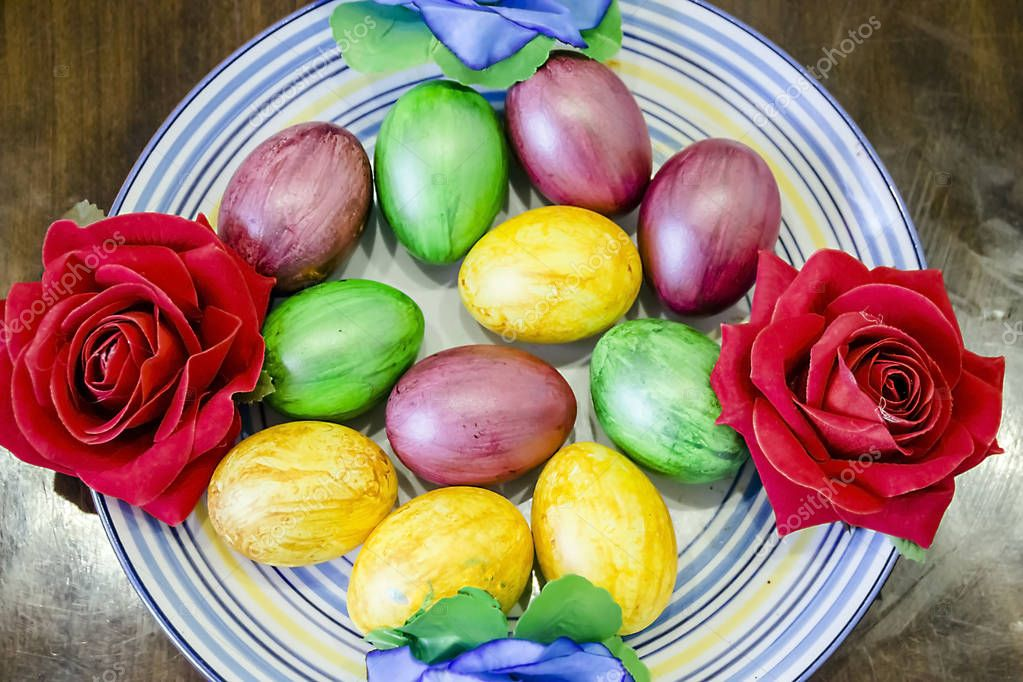 pictured in the photo lots of beautiful colorful Easter eggs on a plate
