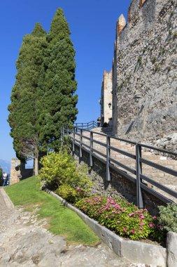 MALCESINE, ITALY - SEPTEMBER 30, 2018: 13th-century medieval stone Scaliger Castle (Castello Scaligero) on Lake Garda, Province of Verona